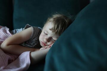 Little girl sleeps in her bed in bedroom. Children's dreams concept