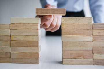 Plan and strategy in business, Risk To Make Business Growth Concept With Wooden Blocks, hand of man...