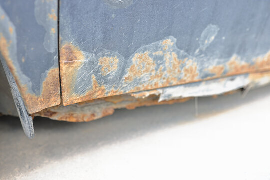 Iron body with elements of rust and corrosion. Processing metal from rust concept