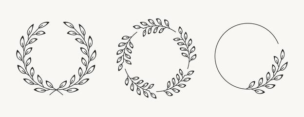 Set of laurel wreath design elements. Black circle border vector ornaments.