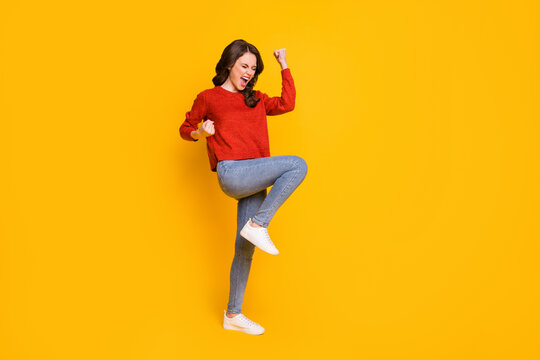 Full length body size view of her she nice-looking attractive content ecstatic overjoyed cheerful cheery wavy-haired girl dancing rejoicing isolated bright vivid shine vibrant yellow color background