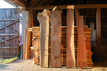Cut wooden boards at woodworker workshop