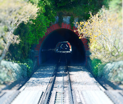 Cable car tracks entering mountain tunnel in Wellington, New Zealand