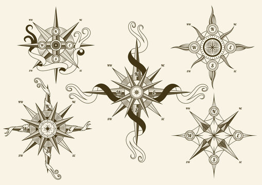 Collection of vintage nautical compass. Old vector design elements for marine theme and heraldry. Hand drawn wind roses