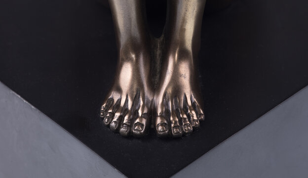 abstract sculpture man legs on black background