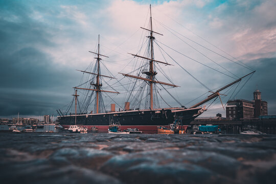 HMS Warrior Birthed in Portsmouth Harbour shot from a low angle