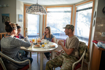 Military family enjoying breakfast at kitchen table