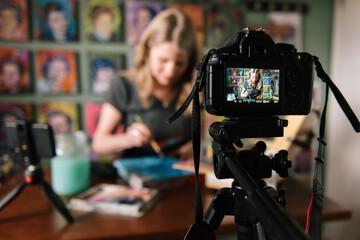 Mature woman filming in art studio