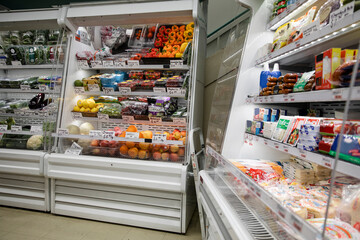 Refrigerated food on shelves in market