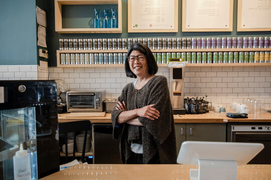 Portrait of cafe owner by counter