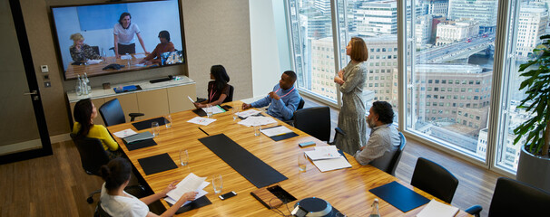 Business people video conferencing in conference room meeting