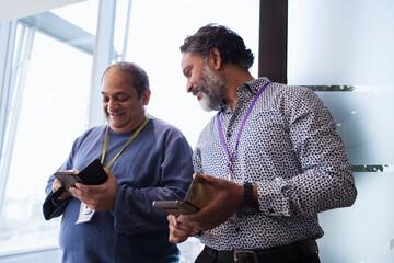Businessmen using smart phones in office