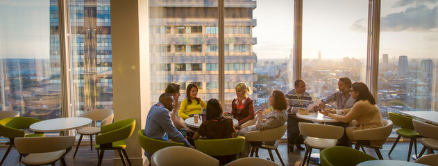 Business people meeting in urban highrise office cafeteria