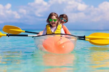 Kids kayaking in ocean. Family in kayak in tropical sea