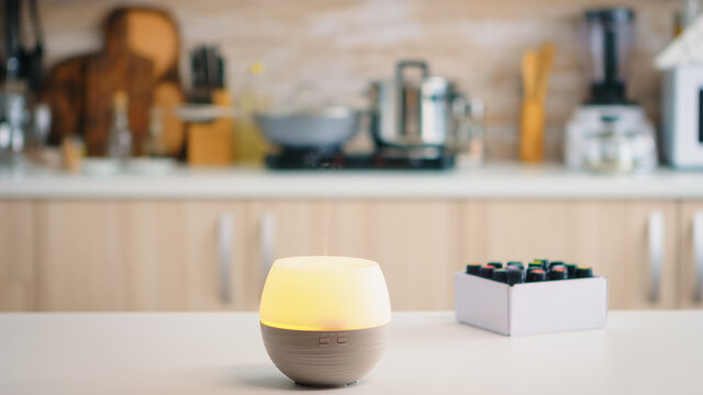 Wellness aromatherapy essential oils diffuser diffusing fragrance into the kitchen. Aroma health essence, welness aromatherapy home spa fragrance tranquil theraphy, therapeutic steam, mental health