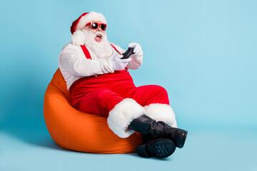 Full length photo of retired old man beard hold gamepad lose game playstation sit orange beanbag...