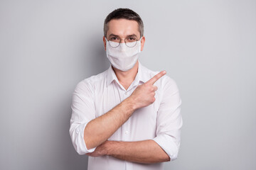 Portrait of his he nice content mature guy wearing safety mask demonstrating copy space stop...