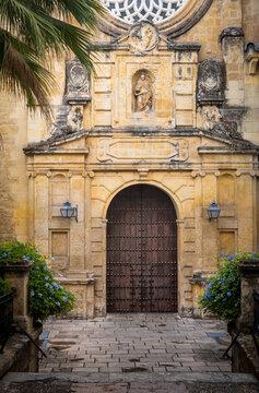 Famous landmark in Spain. Brown door in old arabic style in Cordoba