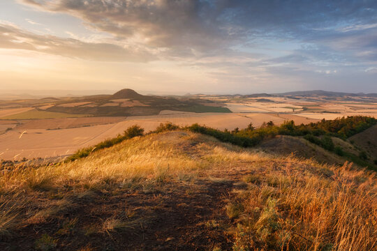 Sunset light over Rana hill and Czech Central mountains (Ceske stredohori), Czechia