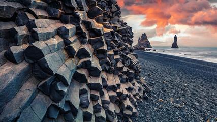 Unbelievable sunset on Reynisdrangar cliffs in Atlantic ocean. Spectacular summer scene of black...