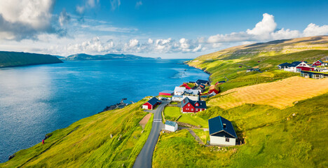 Photo sur Plexiglas Europe du Nord Green summer view from flying droneof Kirkjubour village with Hestur Island on background. Attractive morning scene of Faroe Islands, Denmark, Europe. Beauty of nature concept background.