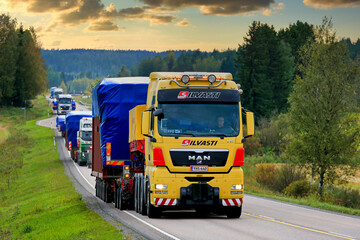 MAN Semi Trailer Leads Wide Load Truck Convoy. Illustrative editorial content.