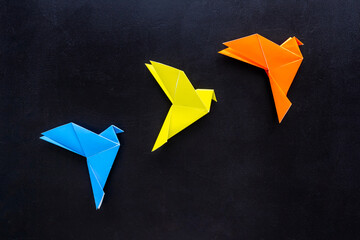 Origami birds are flying, overhead top view
