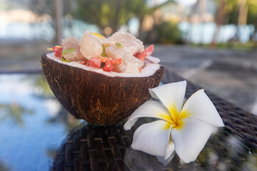 Fresh Poission Cru (raw fish) in a coconut shell.