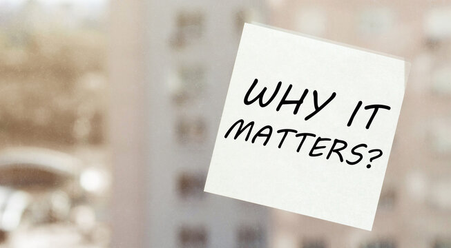 white paper with text Why It Matters on the window