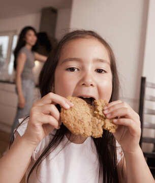Young Girl Eating Cookie