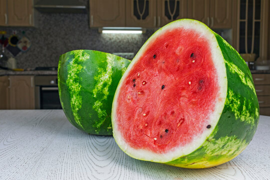 Half a ripe watermelon lying on the kitchen table