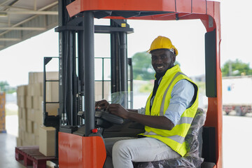 male forklift operator in warehouse,A male lifter in a warehouse, a smiling and friendly worker.