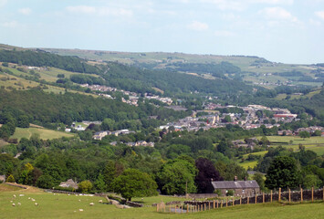 scenic view of the town of mytholmroyd surrounded by woods and fields in the calder valley west yorkshire