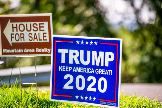 Afton, USA - August 30, 2020: Presidential election political sign in support of Donald J. Trump with Keep America Great 2020 text and house for sale placard, Virginia