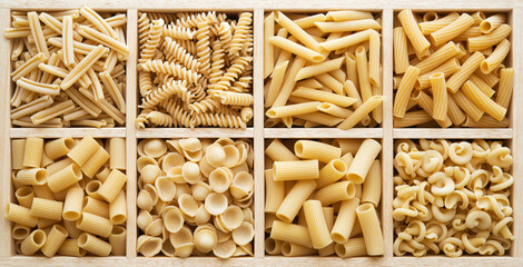 Italian pasta collection in wooden box, eight popular types of macaroni shapes. Top view.