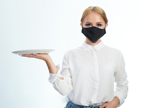 Waitress in mask with plate