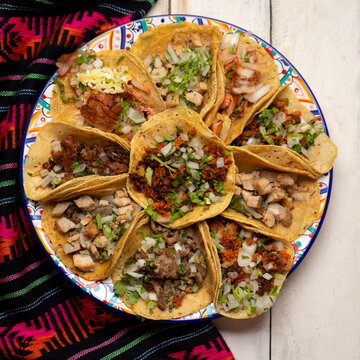 Assortment of mexican tacos on white background