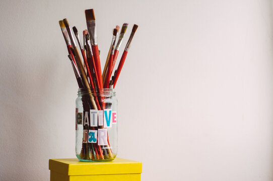 Creative Jar filled with paint brushes