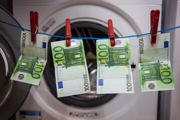 Money attached to a string to dry, symbolically depicted money laundering, crime illegal activity