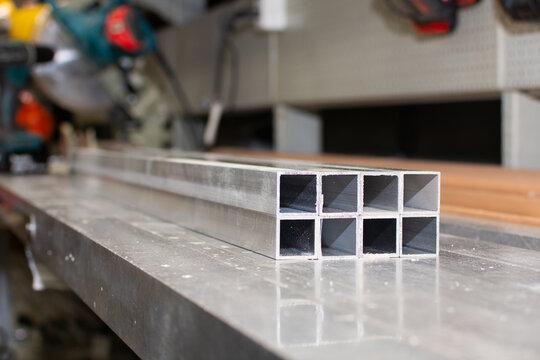 The pipe sections. Aluminium profile for manufacturing. Structural metal aluminium shapes. Aluminium profiles texture for constructions.