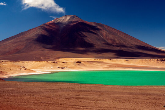 Laguna Verde (Green Lagoon) with emerald waters is located 4200 meters above sea level, surrounded by volcanoes and mountains. Copiapo, Atacama, Chile. Atacama Desert.