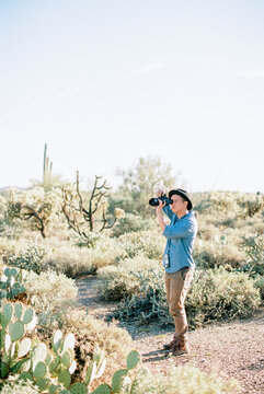 Man taking picture in desert