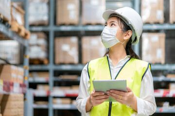 Young asian woman auditor or trainee staff wears mask working during the COVID pandemic in store...