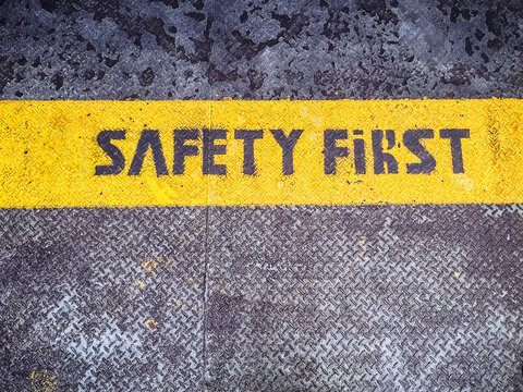 """The words """"""""Safety First"""""""" written on a landing stage"""