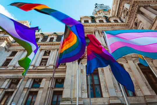 LGBTQIA flags waving in the wind in front of the Philadelphia City Hall during Pride Month