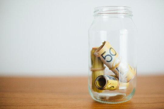 Rolls of Money in a Jar