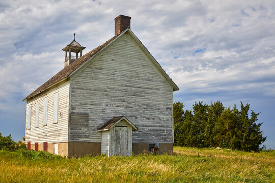 Scenic old one room abandoned school building on the road from Minnesota to North Dakota