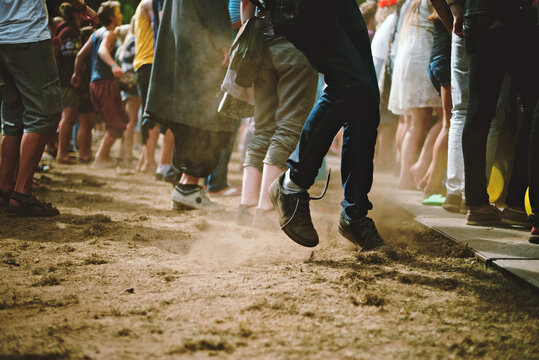 A youngster dancing in dust at a summer festival