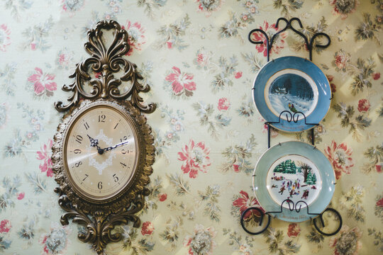 vintage clock and plates hanging on wall