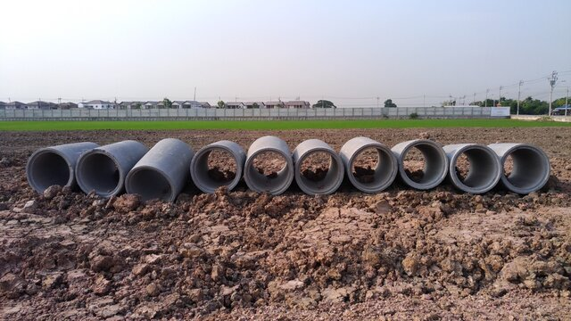 Concrete drainage pipes.Construction of main water supply pipeline. Laying underground storm sewers at construction site. Water main, sanitary sewer, drain systems. Utility Infrastructure